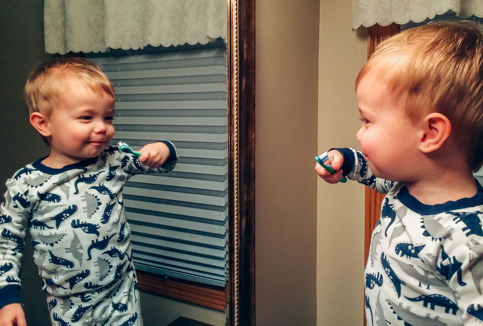 Baby Babyhood Bonding Boys Brother Brushing My Teeth Child Childhood Day Domestic Room Females Indoors  Lifestyles Males  Mirror People Real People Reflection Togetherness Two People