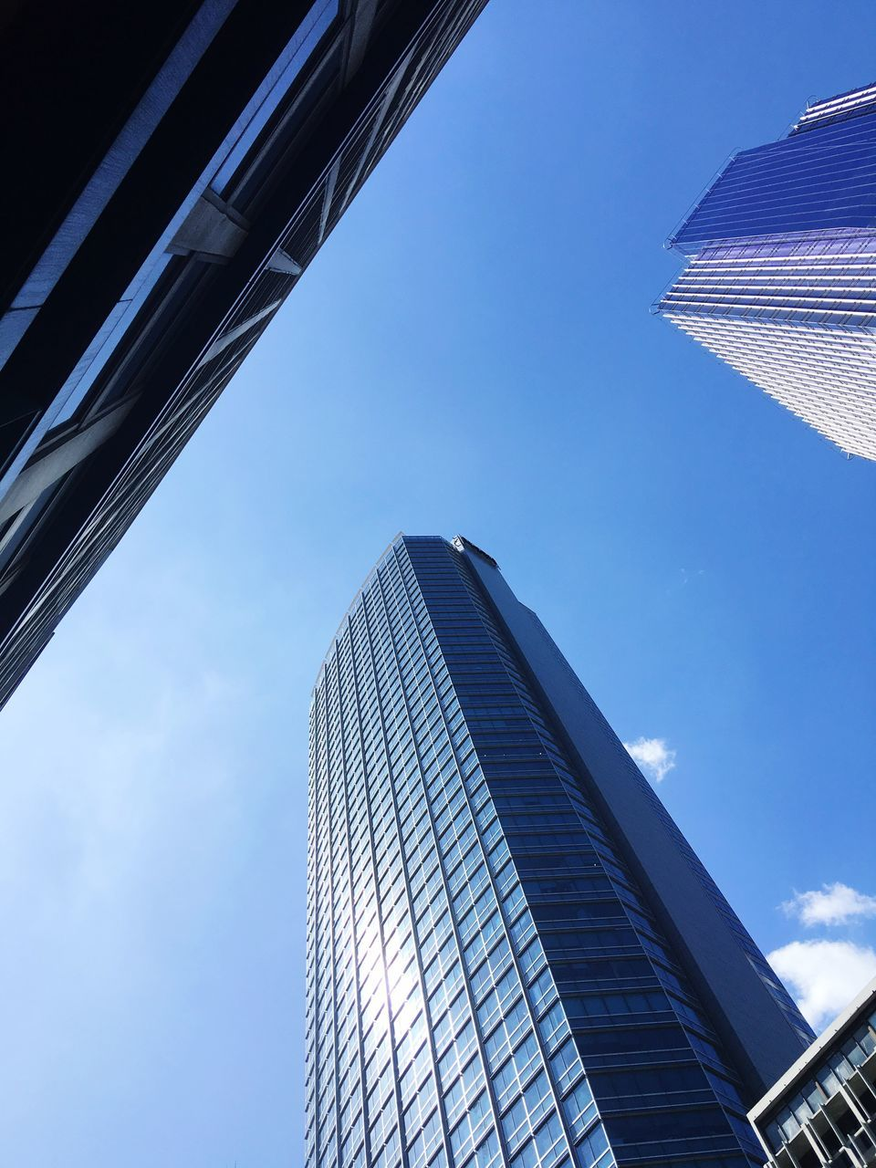 architecture, building exterior, built structure, skyscraper, modern, low angle view, sky, city, day, outdoors, no people, growth, blue, travel destinations, office park