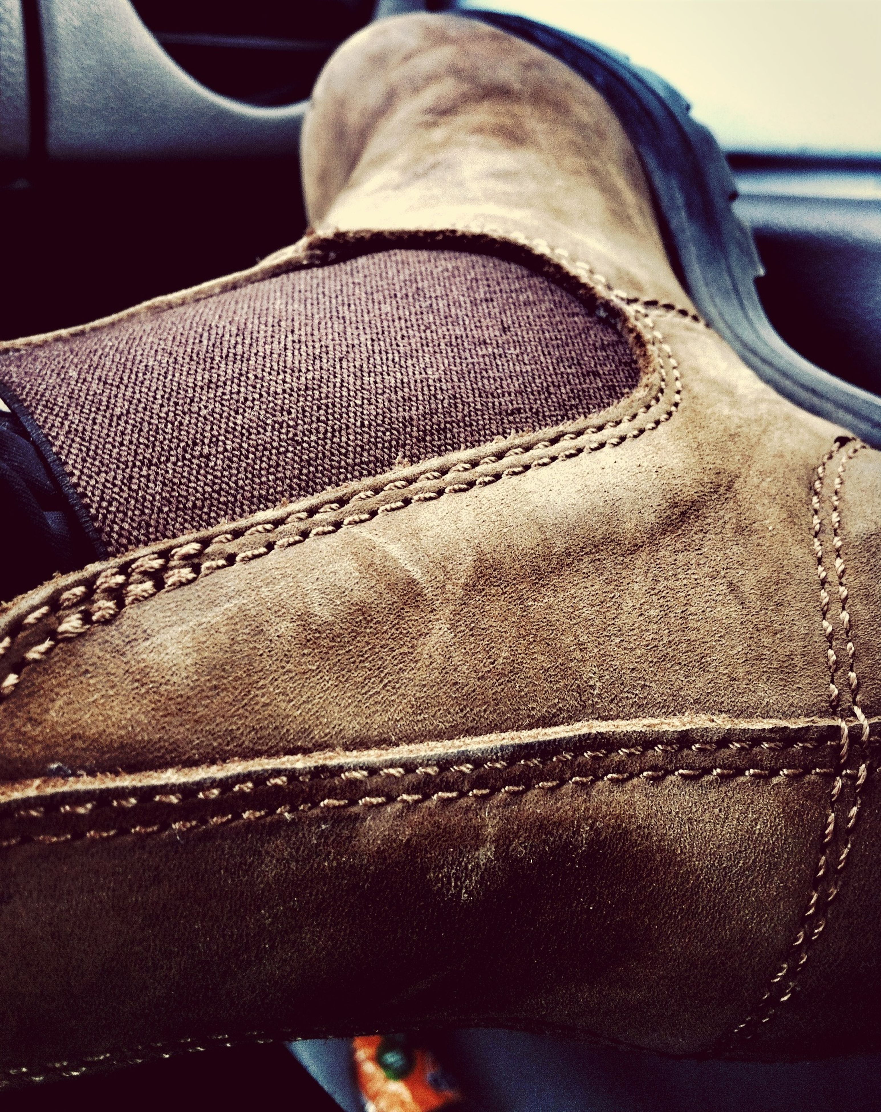close-up, indoors, part of, car, land vehicle, relaxation, high angle view, detail, focus on foreground, transportation, shoe, no people, black color, day, sunlight, jeans, cropped, low section, brown