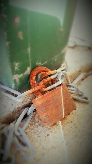 Locked Together Until Rust Tear Us Apart Rustymetal Close-up No People Indoors  Day Chain Lock Locked Up Rusty Red Green Color