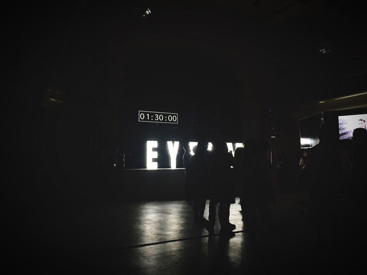 Eyeemfestival16 Urban Lifestyle Light And Shadow Ey Communication Silhouette Night Full Length Dark Public Transport Information Sign Illuminated Group Of People Outline Journey Entrance