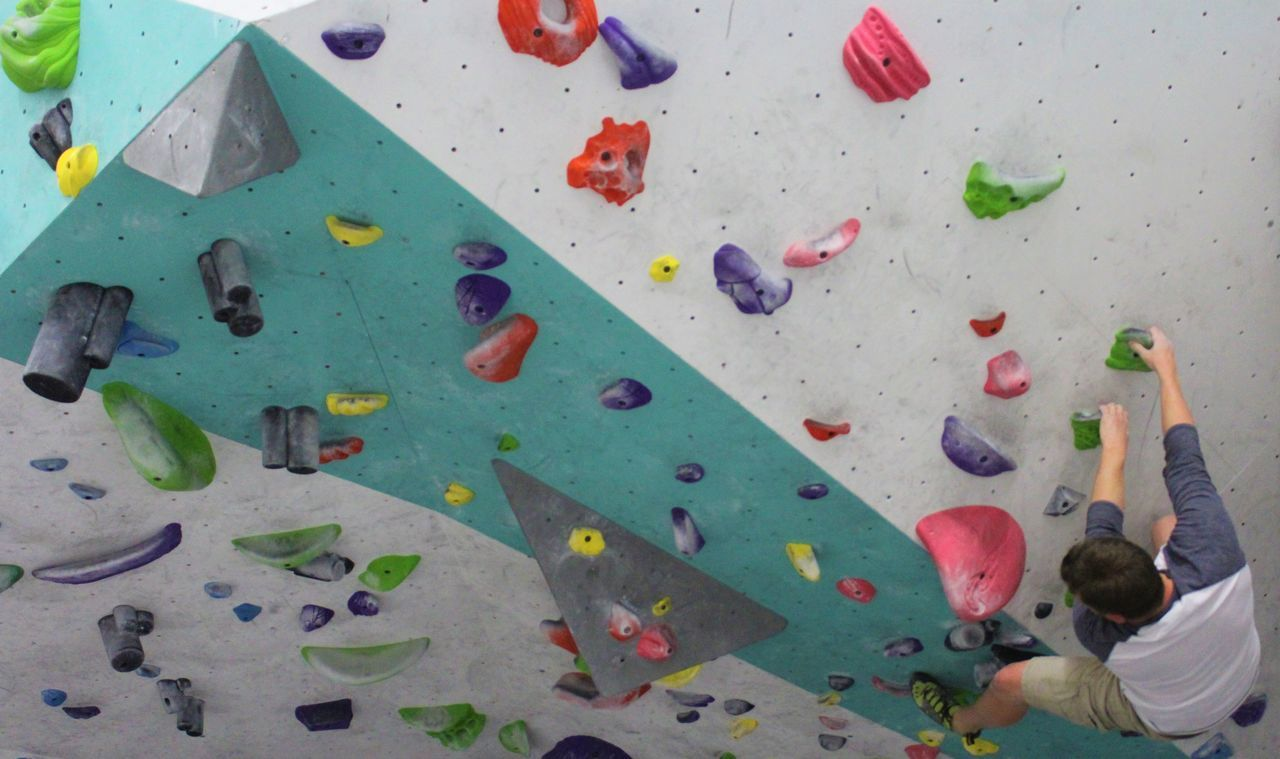 Climbing Wall Healthy Lifestyle Exercising Climbing Multi Colored Challenge Lifestyles Extreme Sports Sport Leisure Activity Effort Rock Climbing Gym Gripping Indoors  Health Club Strength Wellbeing People Self Improvement