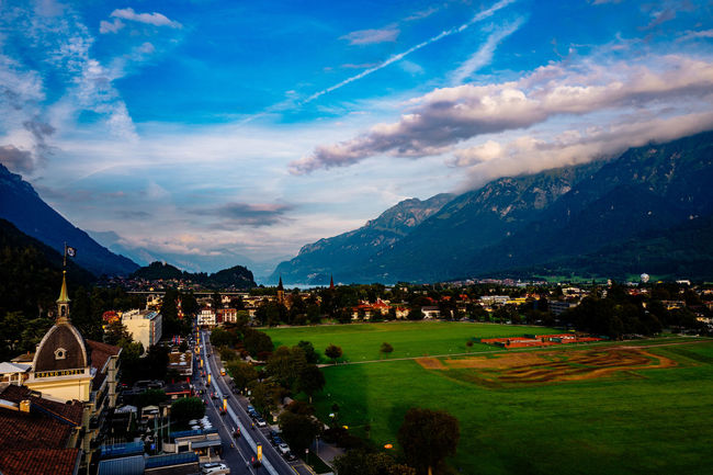 City Life Cloud - Sky Cloudy Green Color High Angle View Interlaken Jungfrau Jungfrau - Top Of Europe Mode Of Transport Mountain Mountain Range Outdoors Residential District Scenics Sky Switzerland The Way Forward Transportation