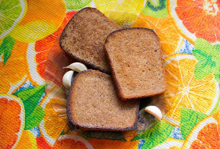 Garlic and bread Beautifully Organized Multi Colored Pattern No People Outdoors Close-up Day Al Themes Mammal Food Indoors  Variation Backgrounds Ready-to-eat Food And Drink Healthy Eating Freshness Bread
