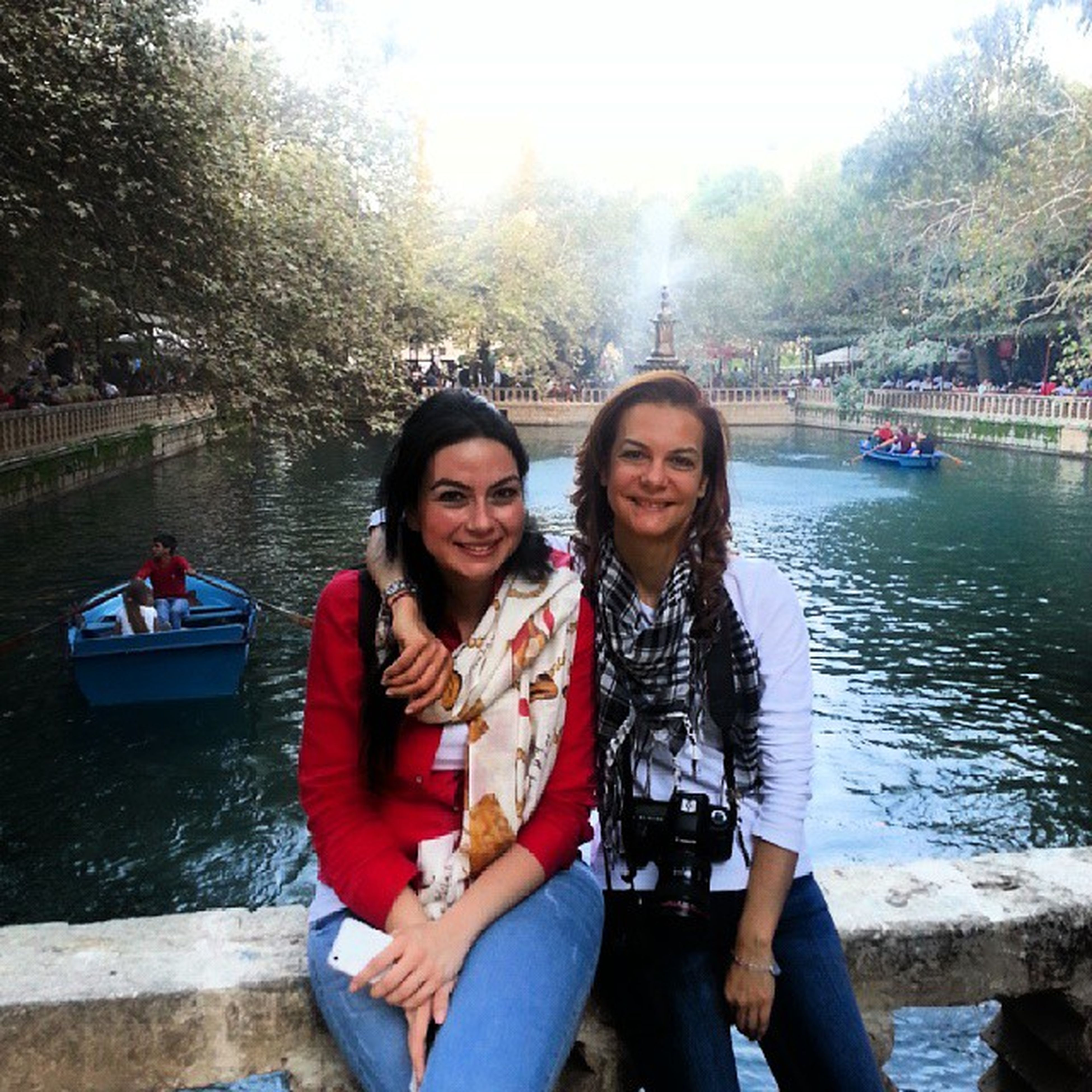 lifestyles, person, looking at camera, portrait, togetherness, leisure activity, smiling, happiness, casual clothing, front view, young adult, bonding, water, young women, love, toothy smile, enjoyment, sitting