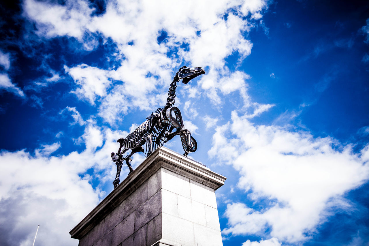 cloud - sky, low angle view, sky, statue, sculpture, architecture, day, outdoors, built structure, blue, no people, building exterior