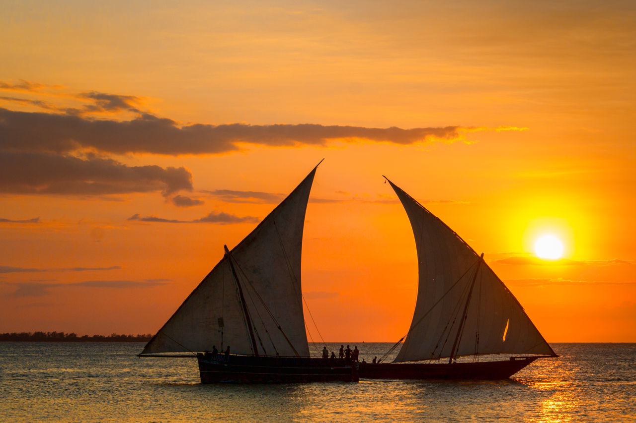 sunset, orange color, sky, scenics, nature, beauty in nature, silhouette, cloud - sky, dramatic sky, nautical vessel, sea, water, tranquility, tranquil scene, outdoors, sun, no people, mast