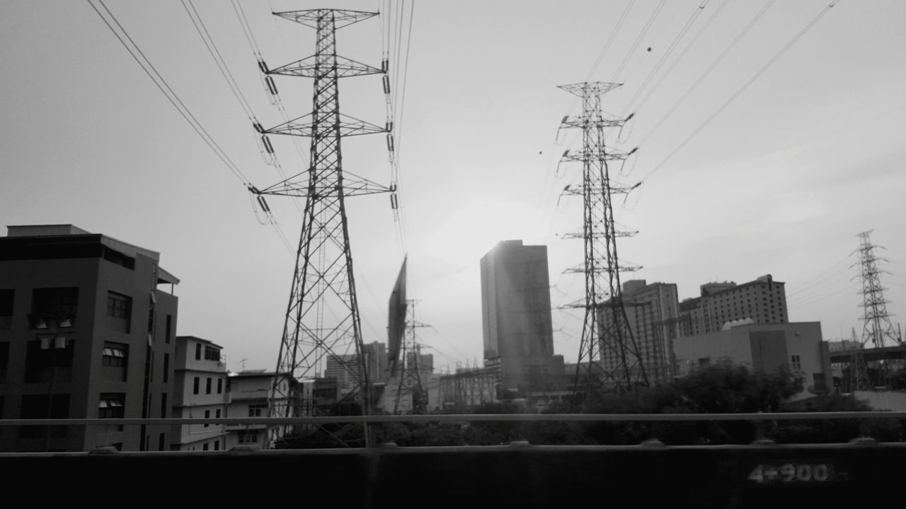 Bangkok City Business Finance And Industry Skyscraper Tower Sky Urban Skyline Building Exterior Electricity Pylon Downtown District Electricity  City Life Built Structure Architecture Cable Modern No People Symmetry Sunset Fog Industry