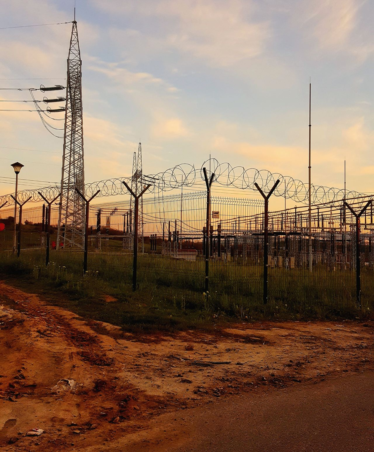 Outdoors Sky Electricity  Power Plant Wire Energy Industry Technology Sky And Clouds Voltage No People Supply Enviroment Production Fence Prison Dawn Station Silhouette Steel