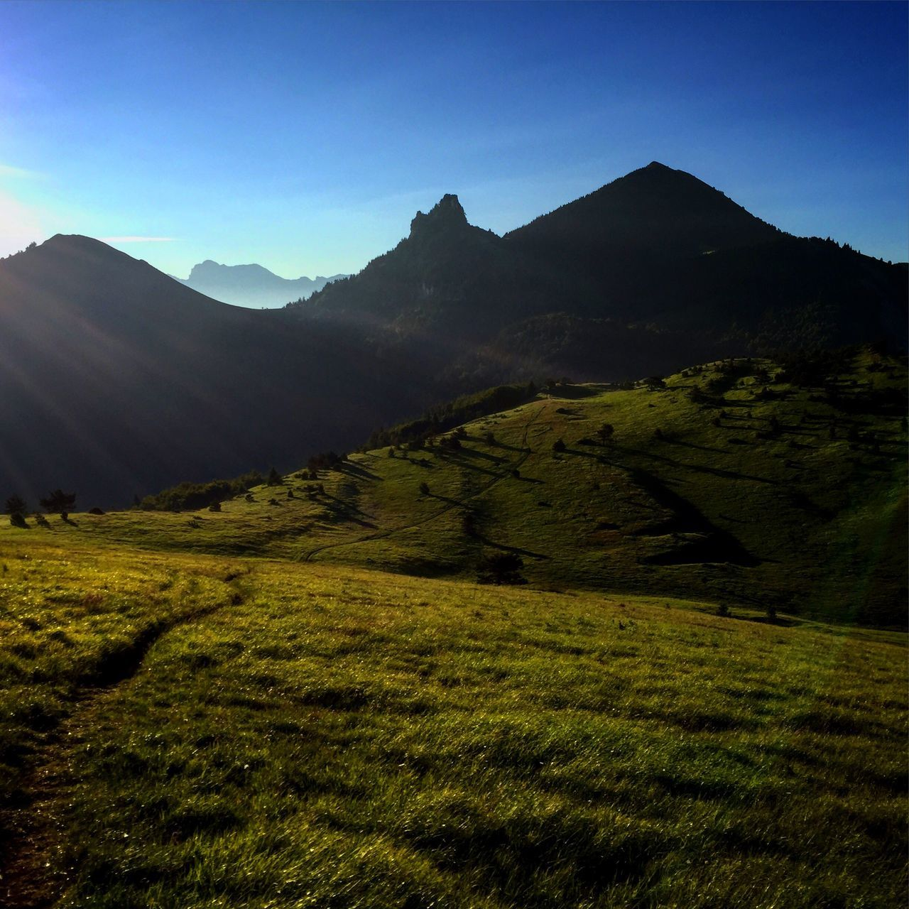 mountain, nature, tranquil scene, tranquility, beauty in nature, scenics, landscape, mountain range, clear sky, no people, day, grass, outdoors, sky, slope