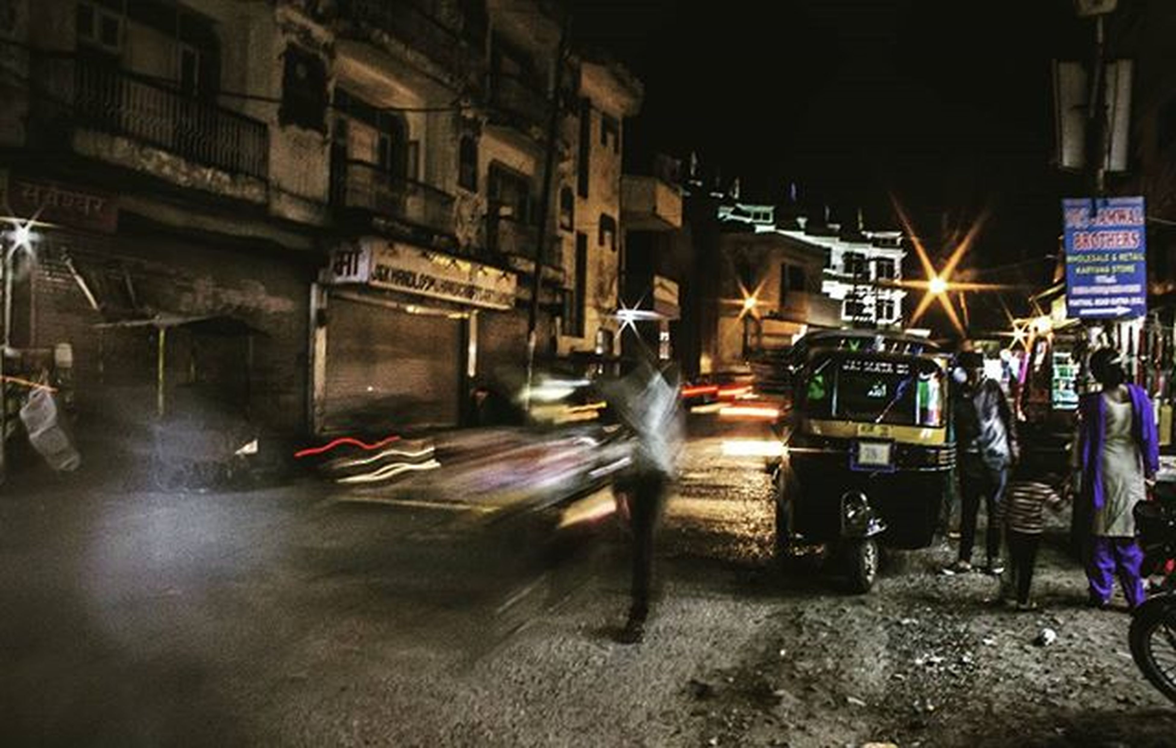 illuminated, men, night, lifestyles, built structure, architecture, person, leisure activity, transportation, indoors, full length, street, building exterior, mode of transport, abandoned, occupation, medium group of people, land vehicle