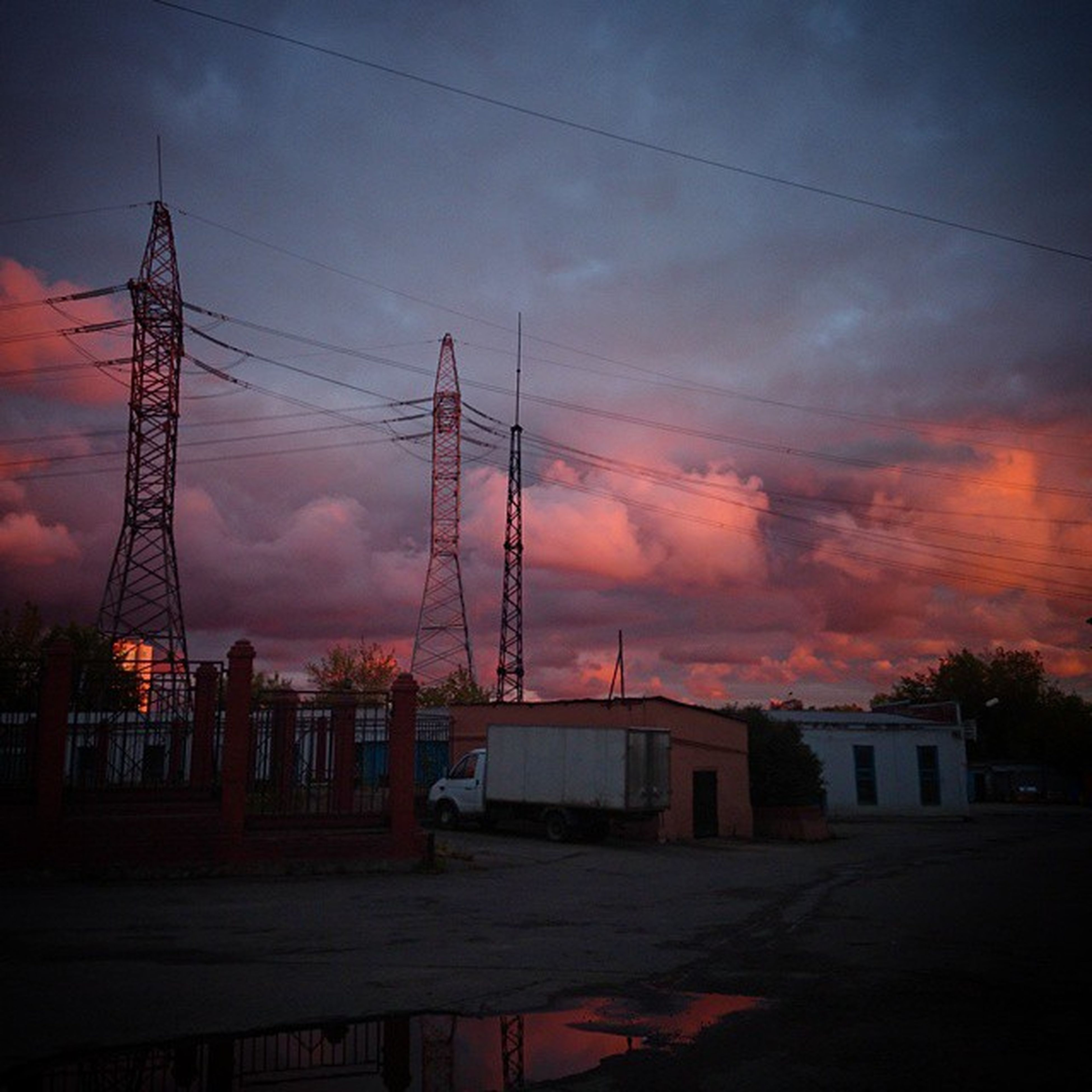 power line, electricity pylon, sunset, power supply, sky, electricity, cable, cloud - sky, building exterior, built structure, connection, architecture, orange color, silhouette, fuel and power generation, cloudy, power cable, cloud, house, technology