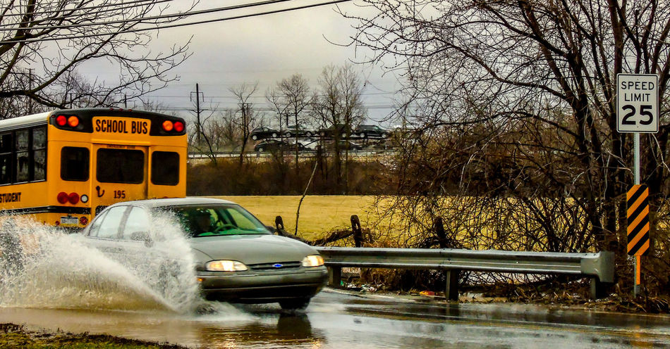 puddle jumpers Atmosphere Bare Trees Cloudy Skies Dangerous Flooding Hydroplane Puddle Jumper, Rain, School Bus Speeding Water