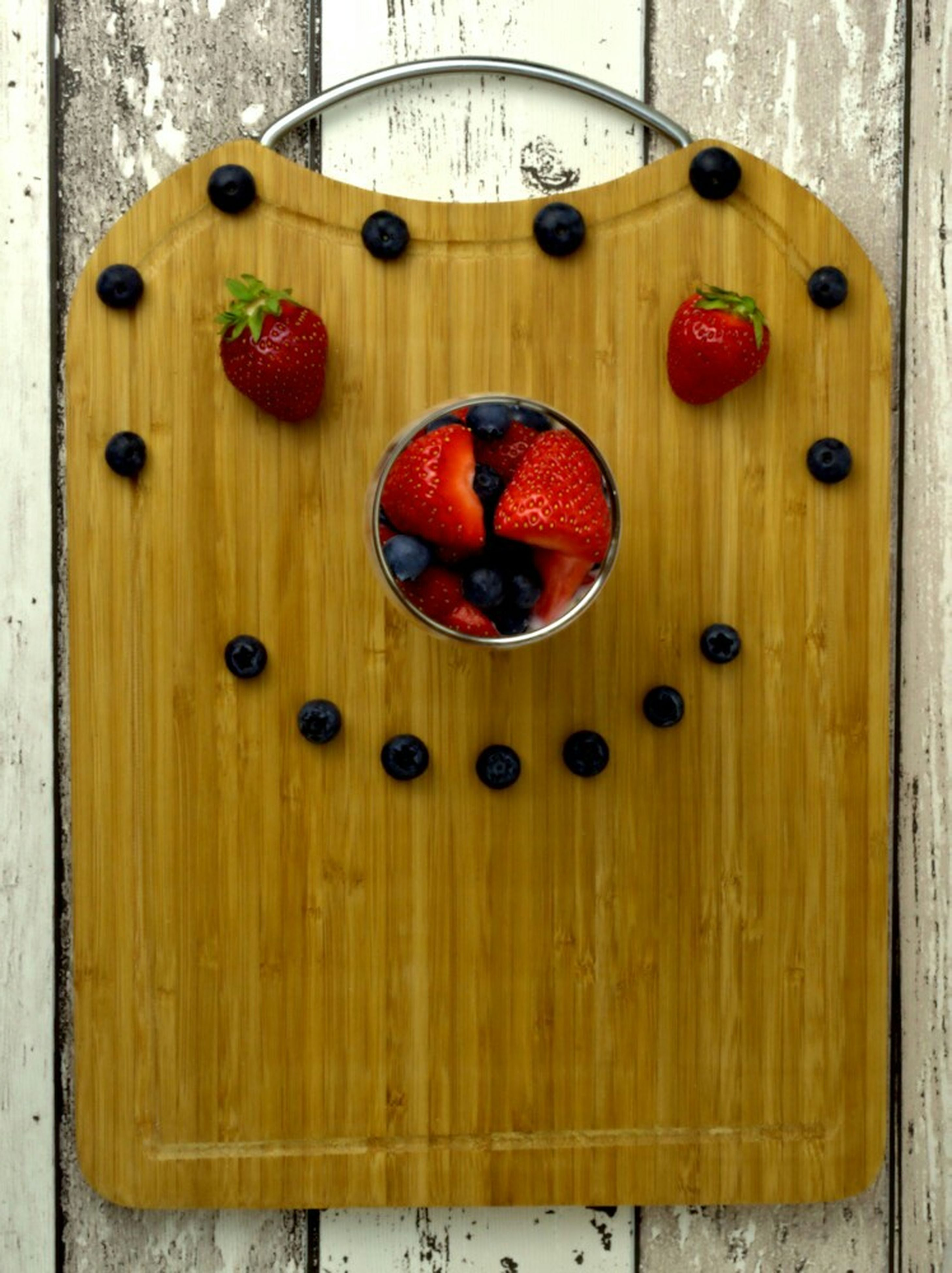 red, indoors, wood - material, circle, close-up, wooden, pattern, metal, directly above, wall - building feature, decoration, no people, door, geometric shape, still life, hanging, built structure, wood, heart shape, day