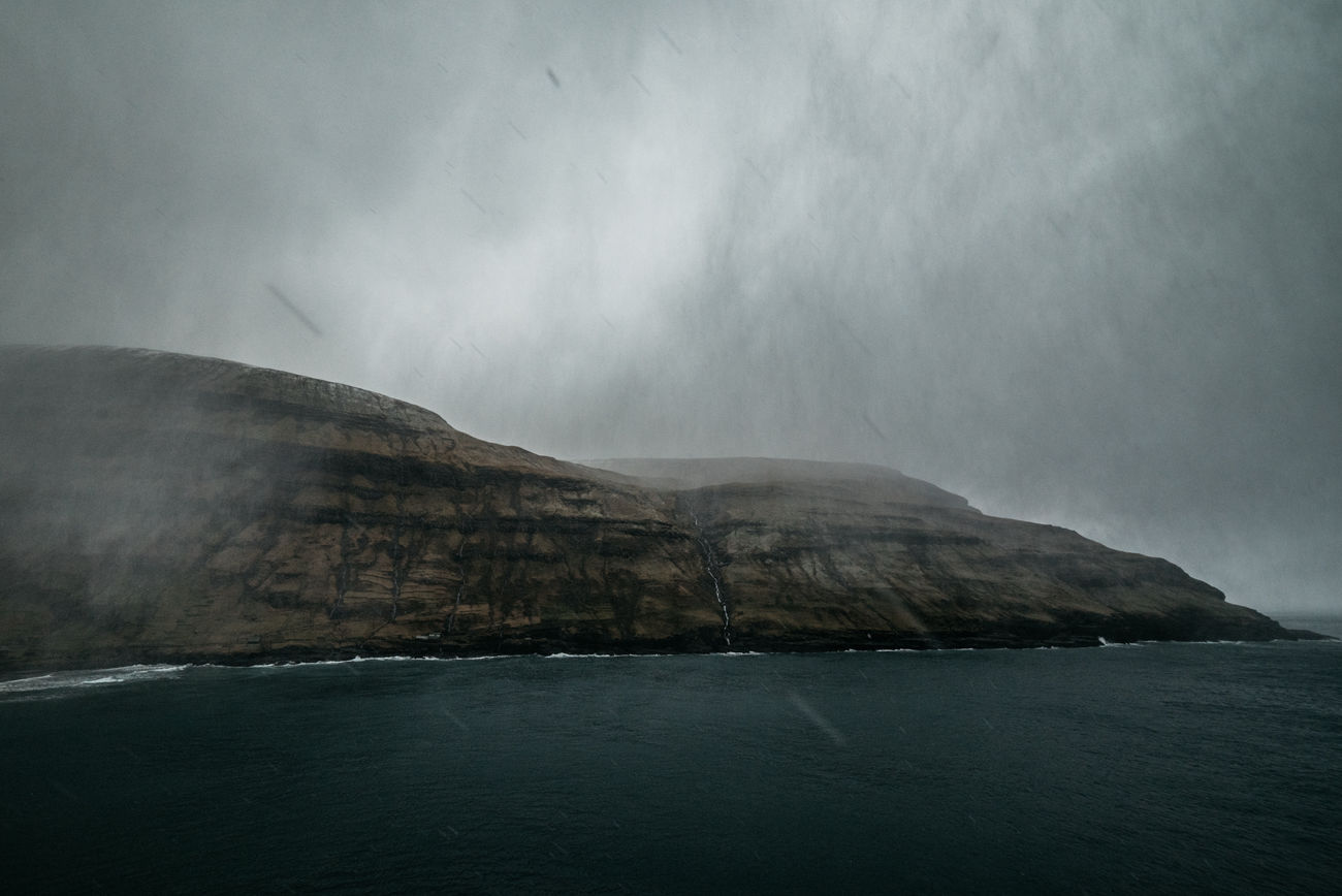 I just returned to my car from a short hike to a higher altitude at one of Faroe's lovely lonely bays. The moment I went in, the rain & hail started. I grabbed my camera and got out. The wind hit me from the left, coming from the mountain range. Hailstones hammered down on me and within 30 seconds the ground was covered in white. I laughed out loud; happy and with a beard full of ice I took a series of shots. 2 Minutes later the sky became blue again. Faroe Islands. Love ya. Bad Weather Bay Beauty In Nature Day Faroe Islands Fjord Hail  Idyllic Landscape Mountain Nature No People Outdoors Physical Geography Rain Scenics Sea Sky The Great Outdoors - 2017 EyeEm Awards Tranquil Scene Tranquility Water Waterfront
