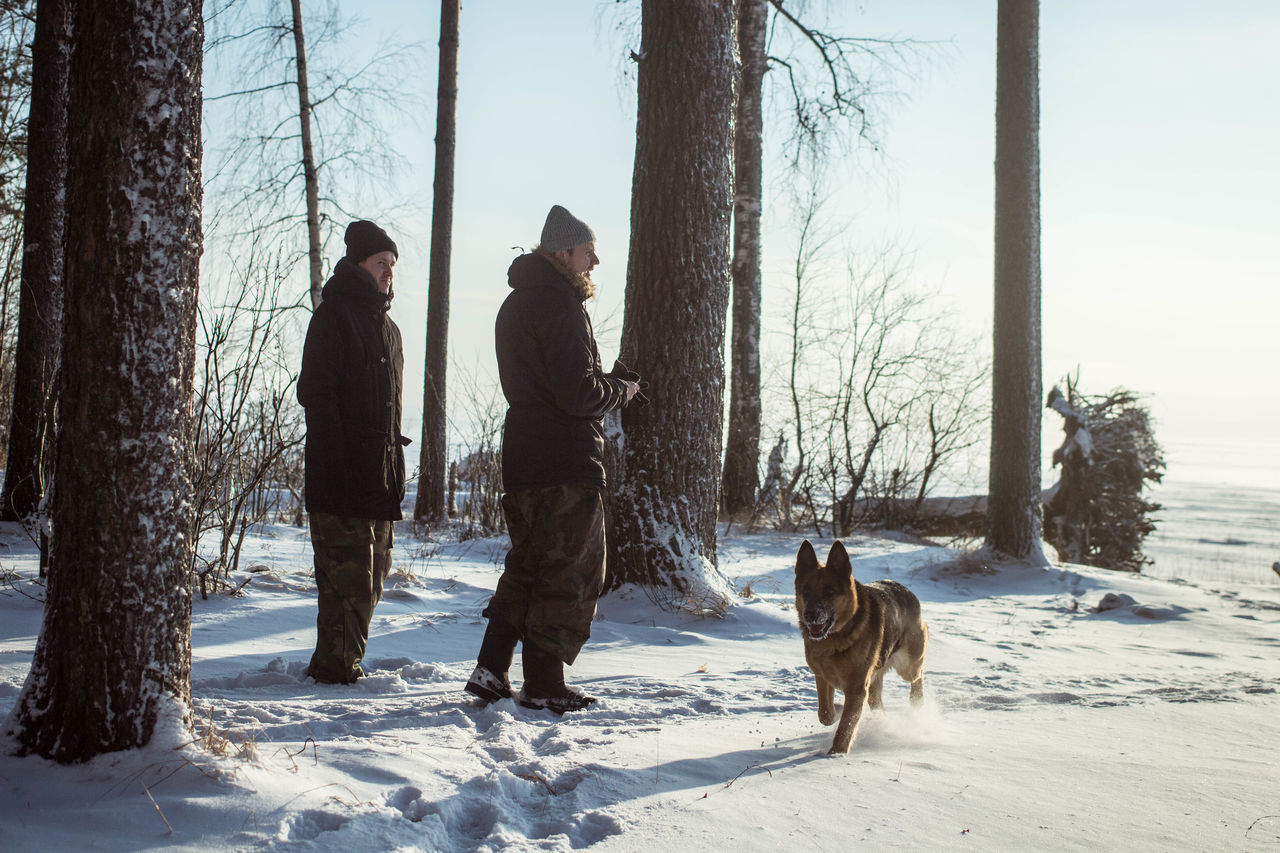 Bare Tree Cold Cold Temperature Day Dog Domestic Animals EyeEmNewHere Freeze Freezing Friendship Frost Frosty Holiday - Event Ice Landscape Lifestyles Men Outdoors People Pets Snow Snow Covered Warm Clothing Winter Young Adult