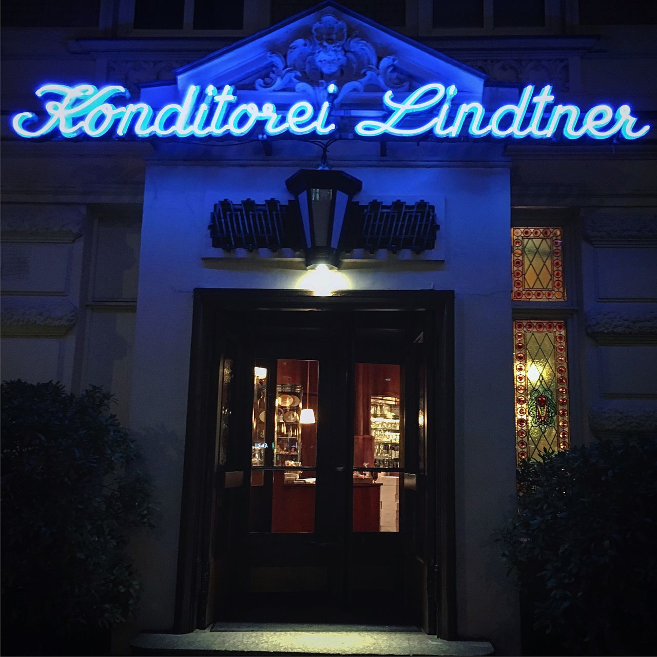 Illuminated Night Architecture Building Exterior Built Structure Blue Entrance Neon Outdoors No People Low Angle View Text Hamburg Konditorei Bluelight Eppendorf Germany