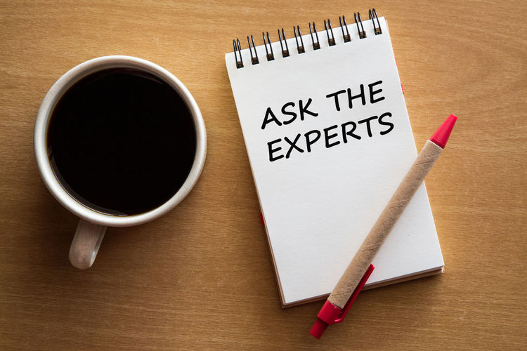 Ask the experts, business concept Advice Adviser Aşk Background Book Brainstorming Business Finance And Industry Close-up Coffee Cup Concept Consultant Directly Above Drink Expertise Help High Angle View Management Motivation No People Notebook Opportunity Paper Plan Refreshment Table