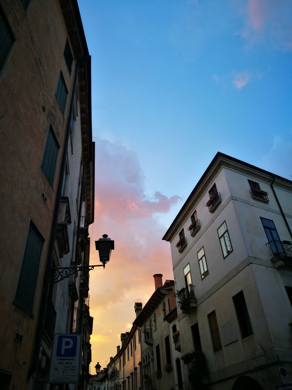 building exterior, architecture, built structure, sky, building, low angle view, residential building, outdoors, no people, city, sunset, day