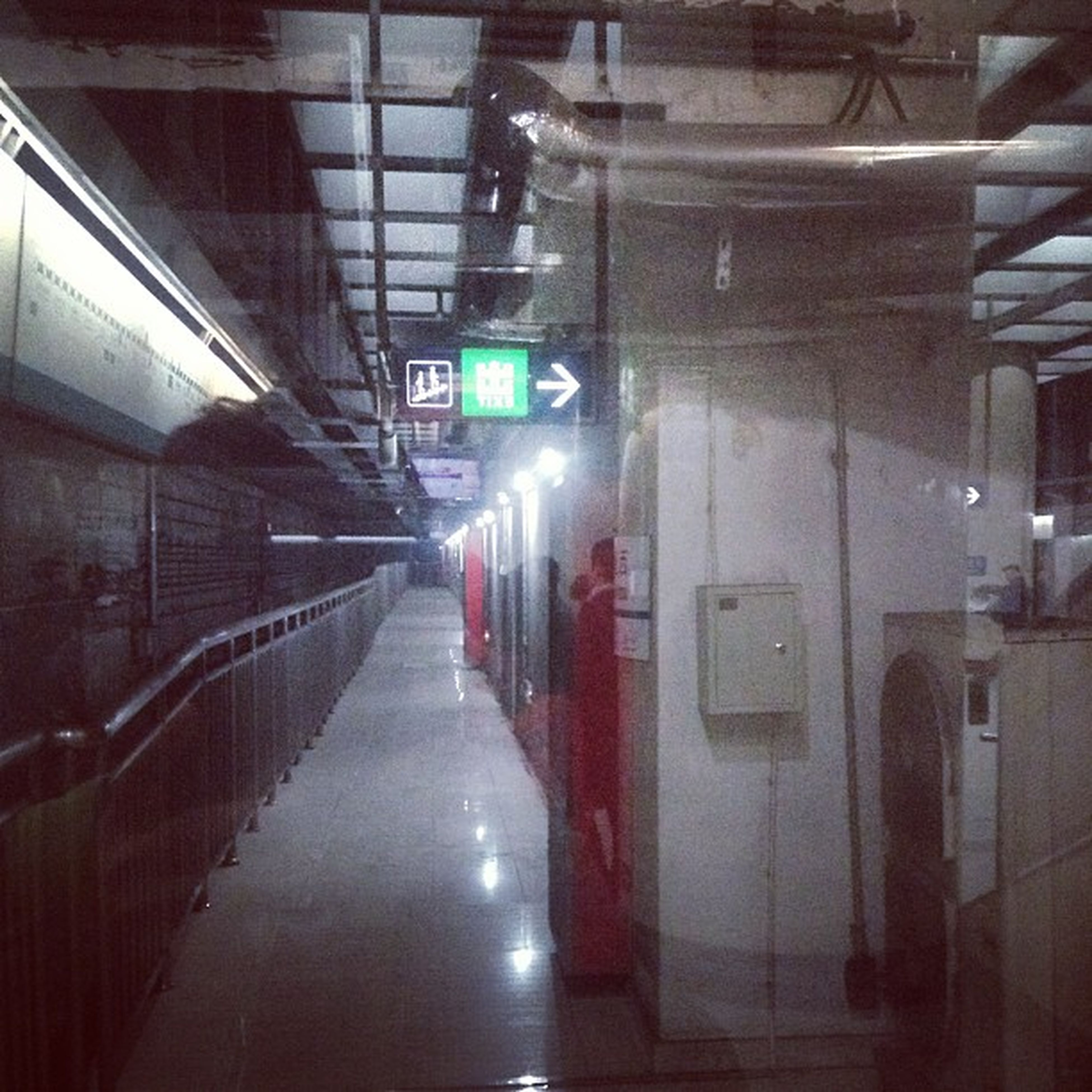 indoors, architecture, built structure, illuminated, transportation, the way forward, public transportation, railroad station, railroad station platform, rail transportation, diminishing perspective, subway station, incidental people, ceiling, railroad track, lighting equipment, empty, reflection, train - vehicle, city
