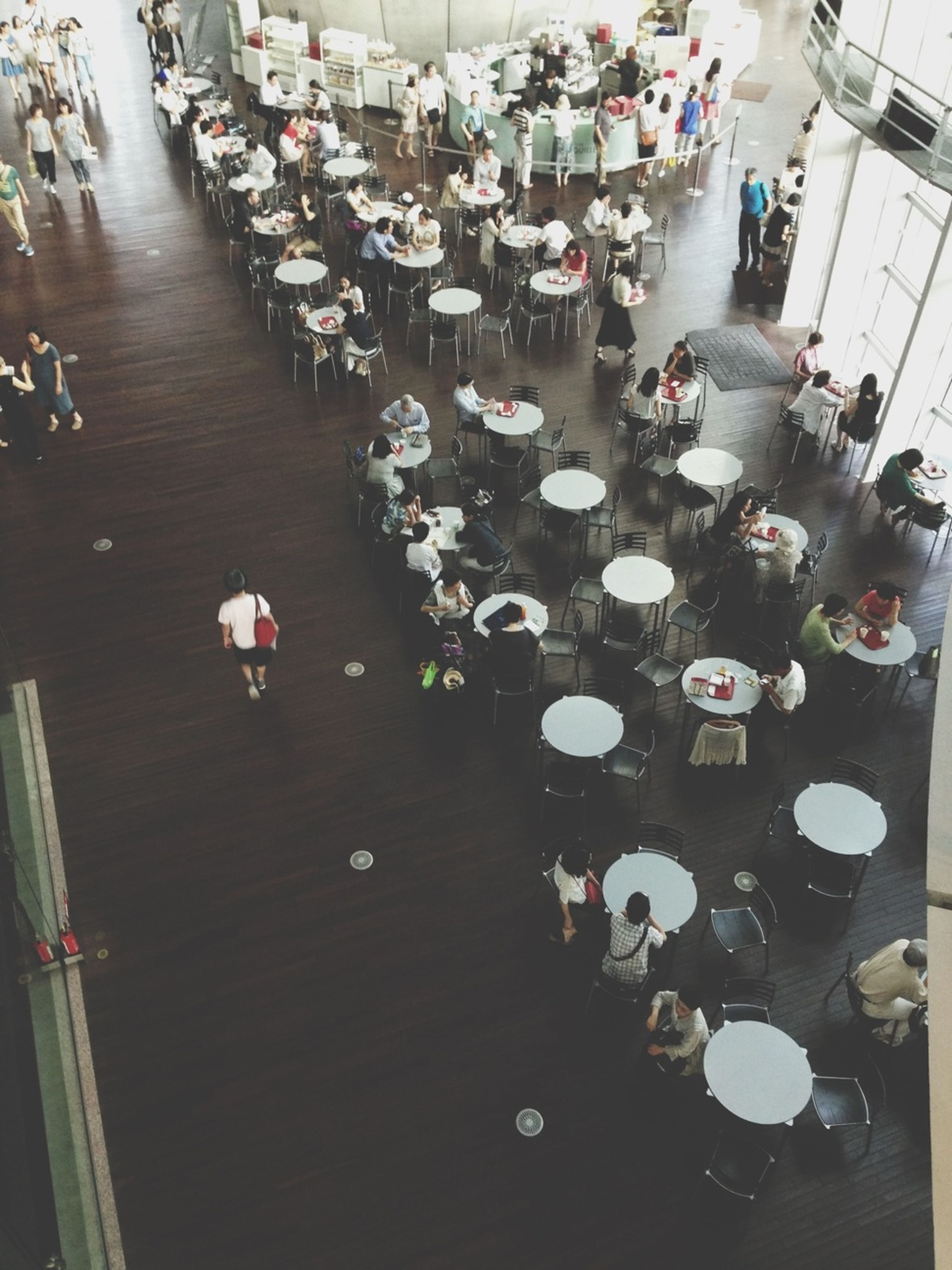 high angle view, large group of objects, table, indoors, abundance, arrangement, variation, in a row, chair, choice, wood - material, restaurant, still life, no people, collection, day, incidental people, elevated view, order, absence
