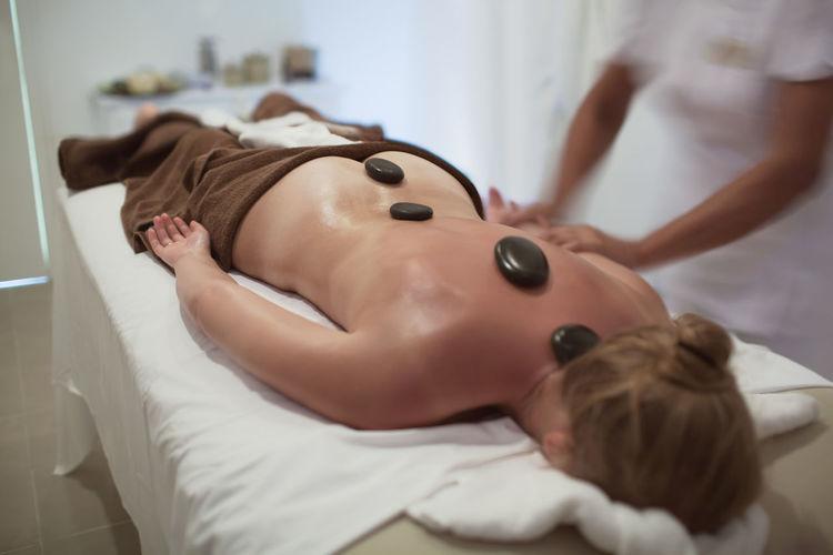 Beauty Salon Beauty Spa Bodycare Caucasian Comfortable Horizontal Hot Stone Massage Massagist Professional Relaxation Relaxing Skincare Spa Still Life Stone Therapy Treatment Woman Zena4ever