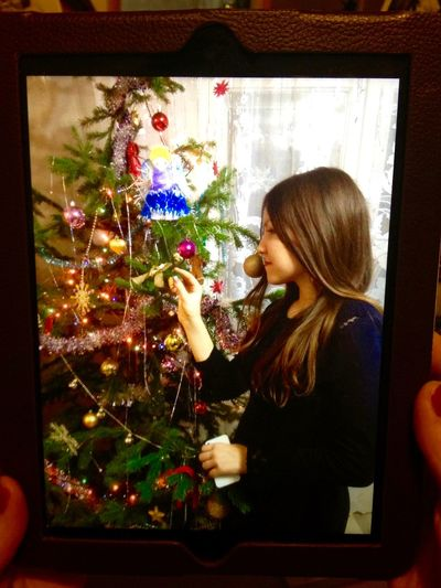 Casual Clothing Christmas Christmas Tree Holding Holiday Long Hair New Year Photo Photography Smart Phone Tablet Taking Photos Taking Pictures Watching The Photo Wireless Technology Young Women Portrait Of A Woman Portrait