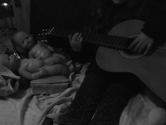 Playing for the doll... Monochrome Photography EyeEm Gallery Personal Perspective EyeEm Best Shots Indoors  Kids Of EyeEm Children Photography Playing The Guitar Musical Instrument Doll Photography Black & White Black And White Monochrome Black And White Photography Human Body Part Girl