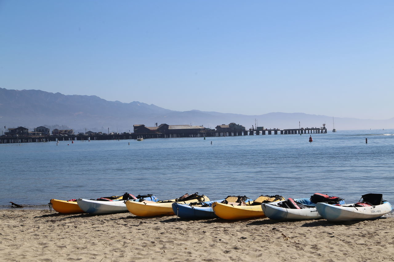 Beach Canoes Day In A Row No People Outdoors Pedal Boat Sky Summer Tranquil Scene Water Watersports