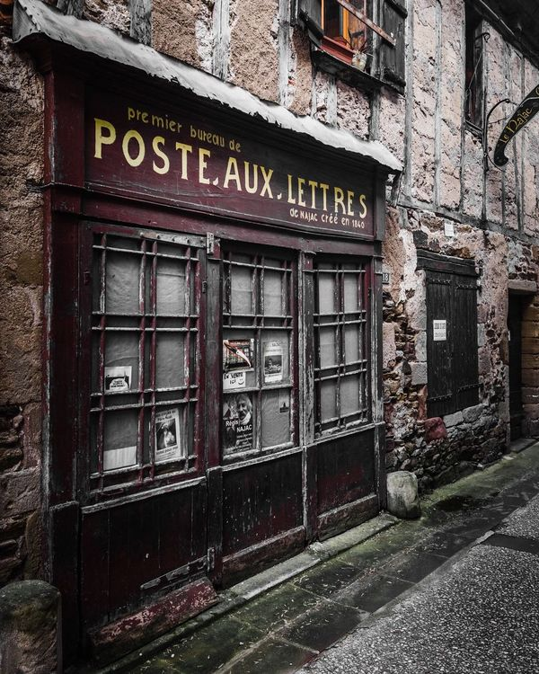 Post office in France Postoffice La Poste Façade French Village Najac Street View Aveyron France Streets Old Village Doorsandwindowsoftheworld Postbox Post Office Postcardsfromtheworld Post Box  France Old Village France