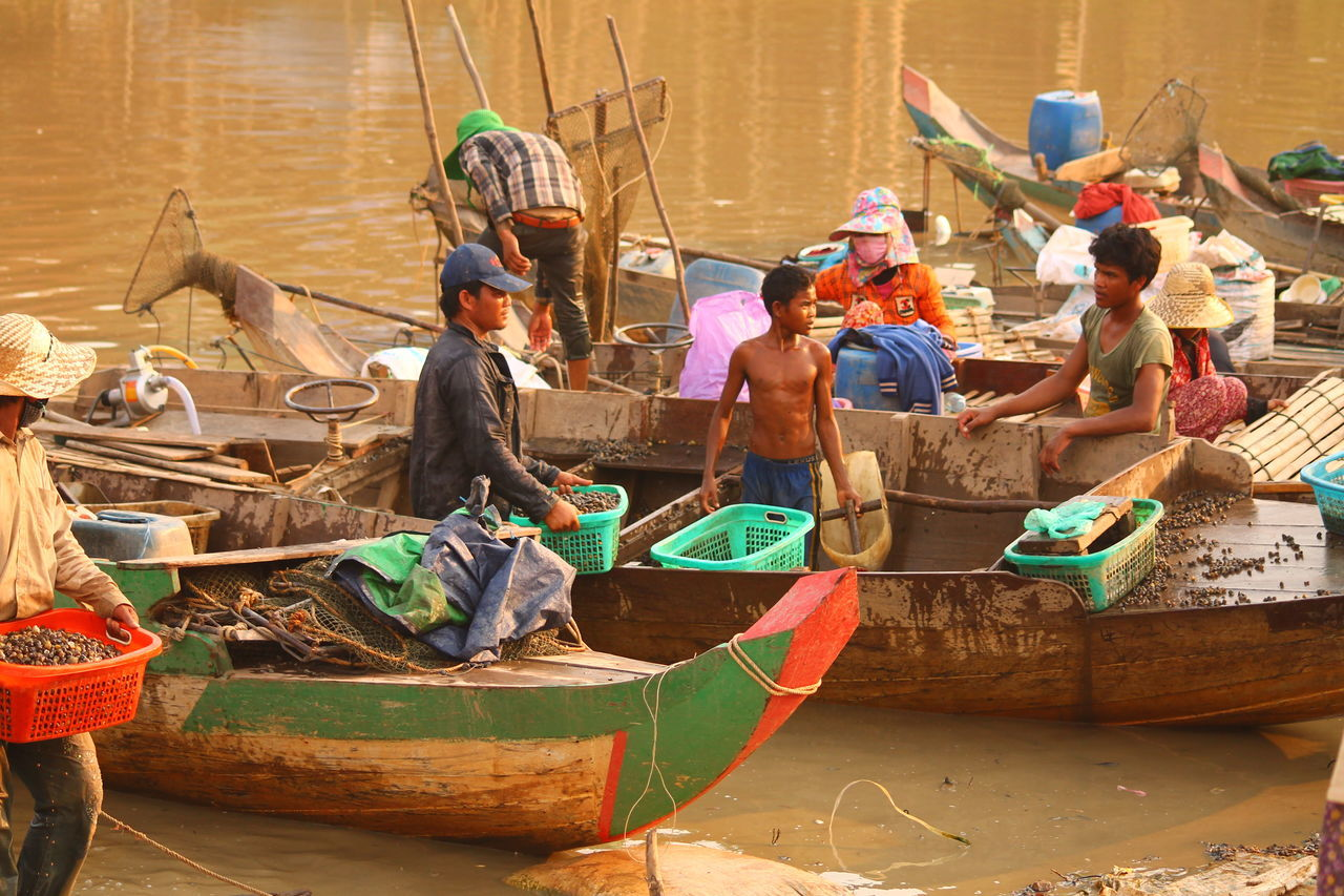 nautical vessel, occupation, transportation, men, working, mode of transport, real people, fishing net, fisherman, day, large group of people, sitting, outdoors, women, rowing, oar, manual worker, adult, people, adults only