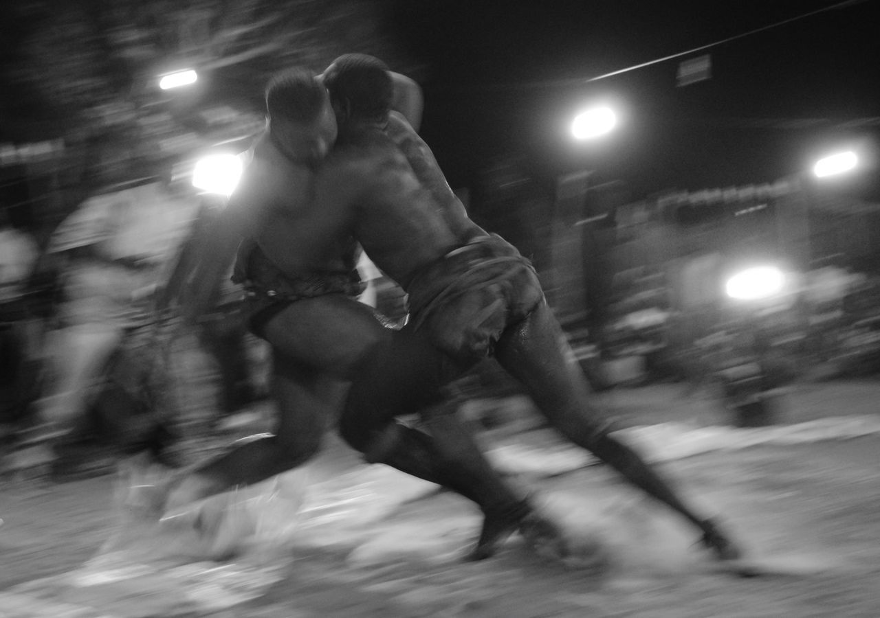 The Photojournalist - 2017 EyeEm Awards Two Wrestlers in full combat. Mussels Blurred Motion Night Shirtless Motion Speed Real People Lifestyles Illuminated Sport Strength One Person Skill  Men Leisure Activity Competitive Sport Full Length Competition Sportsman Muscular Build Outdoors