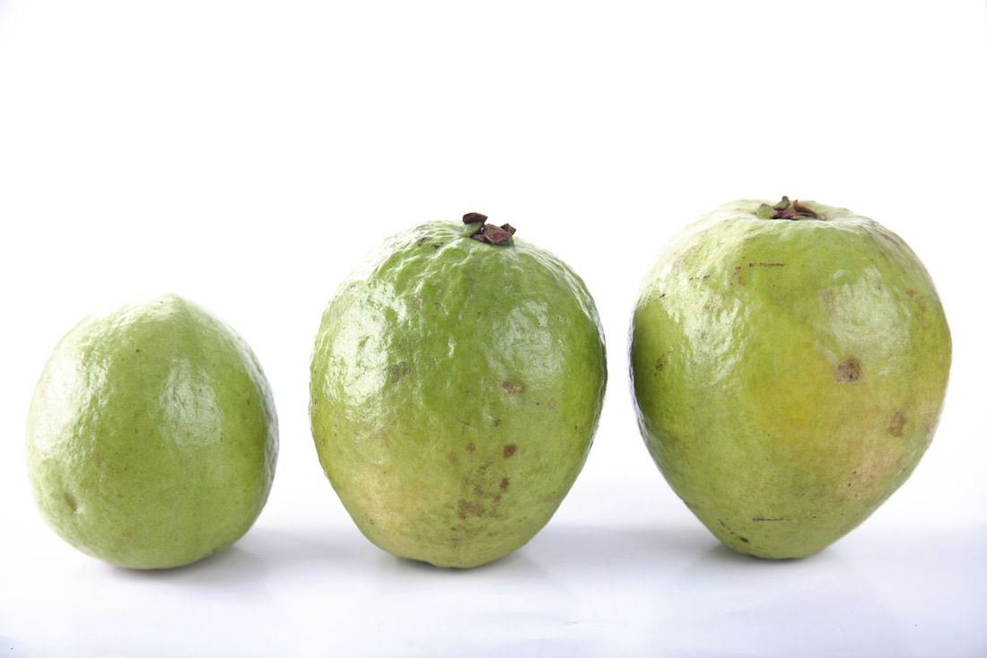 Guava on White Background Close-up Food Food And Drink Freshness Fruit Guava  Guava Fruit Guavas Healthy Eating No People Still Life Studio Shot Vegetable Vitamin White Background