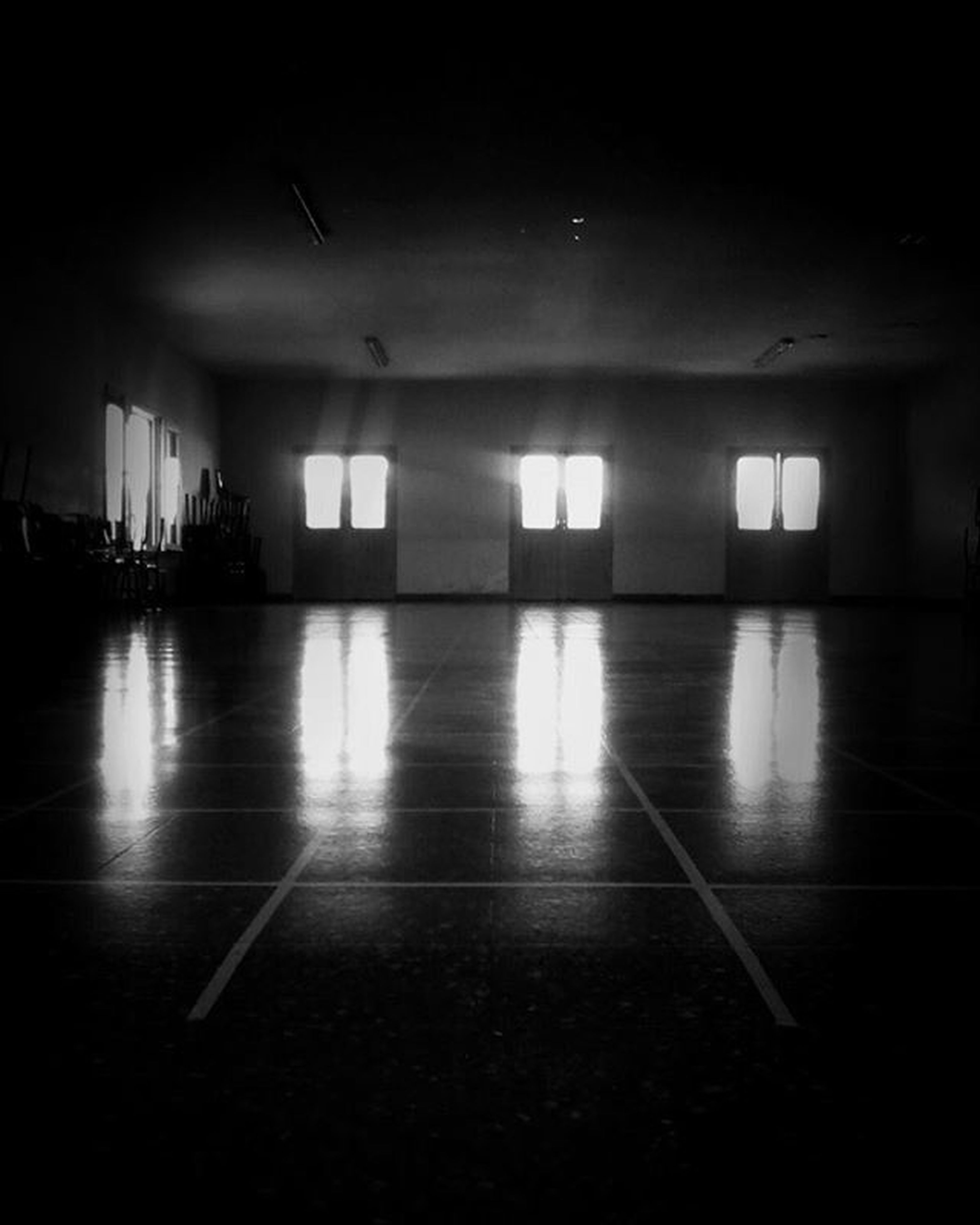 indoors, illuminated, architecture, flooring, built structure, corridor, empty, ceiling, tiled floor, lighting equipment, the way forward, reflection, absence, interior, building, floor, window, wall - building feature, tile, light - natural phenomenon