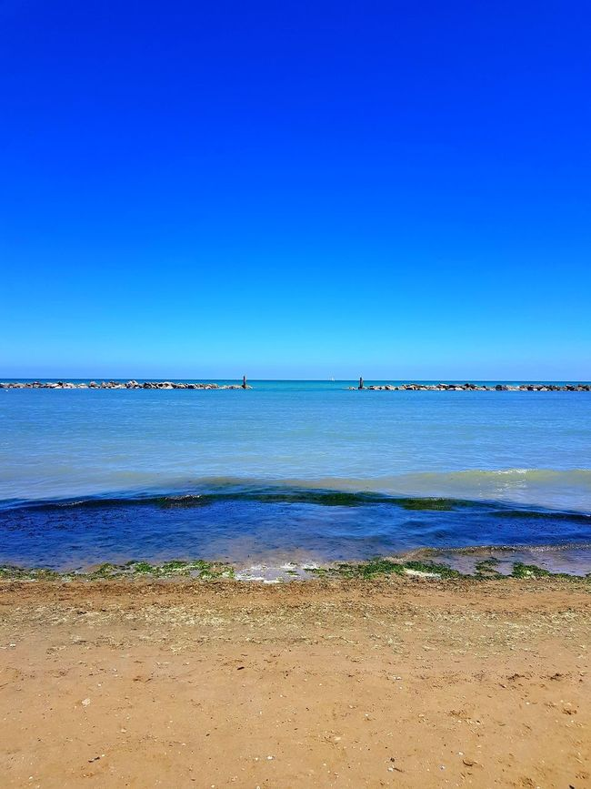 The good days Beach Sea Water Blue Sky Sunny Nature Horizon Over Water Beauty In Nature Clear Sky Outdoors Sand Tranquility Scenics No People Day Vacations Travel Destinations Senigallia Senigallia Beach Senigalliainunclic Senigallia Italy