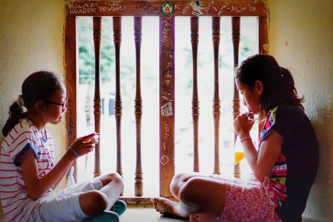 Sitting for a momemnt at Tamansari palace, Yogyakarta. Traveling Photography Travelingindonesia Yogyakarta Story Tamansaripalace Tamansariyogyakarta Humaninterestphotography Twosisters