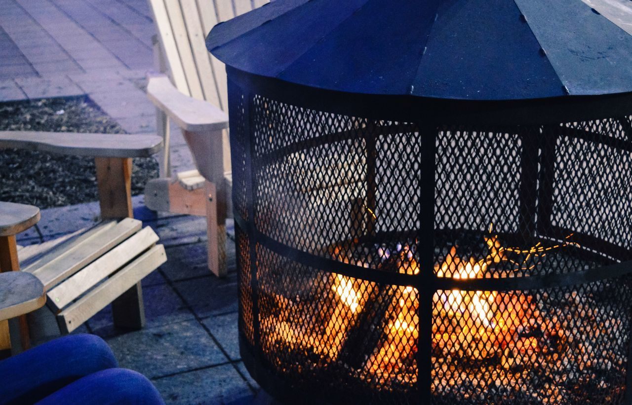 Always Be Cozy Cozy bright burning fireplace sitting outdoors warming up from the cold weather in the winter holiday season Fire - Natural Phenomenon Heat - Temperature Burning Flame Metal Grate Food Food And Drink Freshness Fire Pit Illuminated Outdoors Day Healthy Lifestyle Christmas Holiday Vacation Romance Romantic Place Embers Patio Burning Environment Fireplace Travel