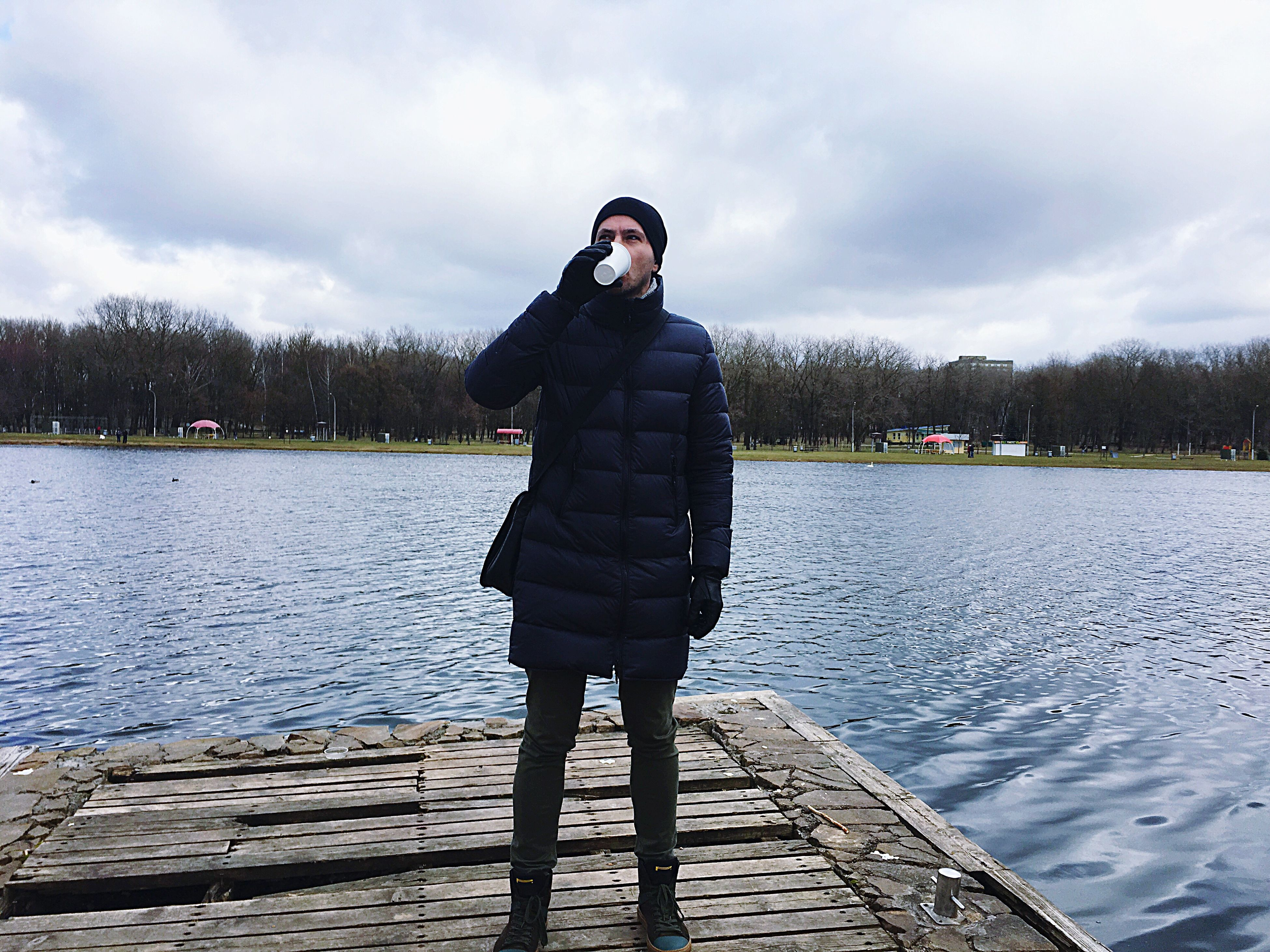 one man only, one person, lake, only men, adults only, reflection, people, men, environment, water, nature, adult, young adult, outdoors, day, warm clothing, sky