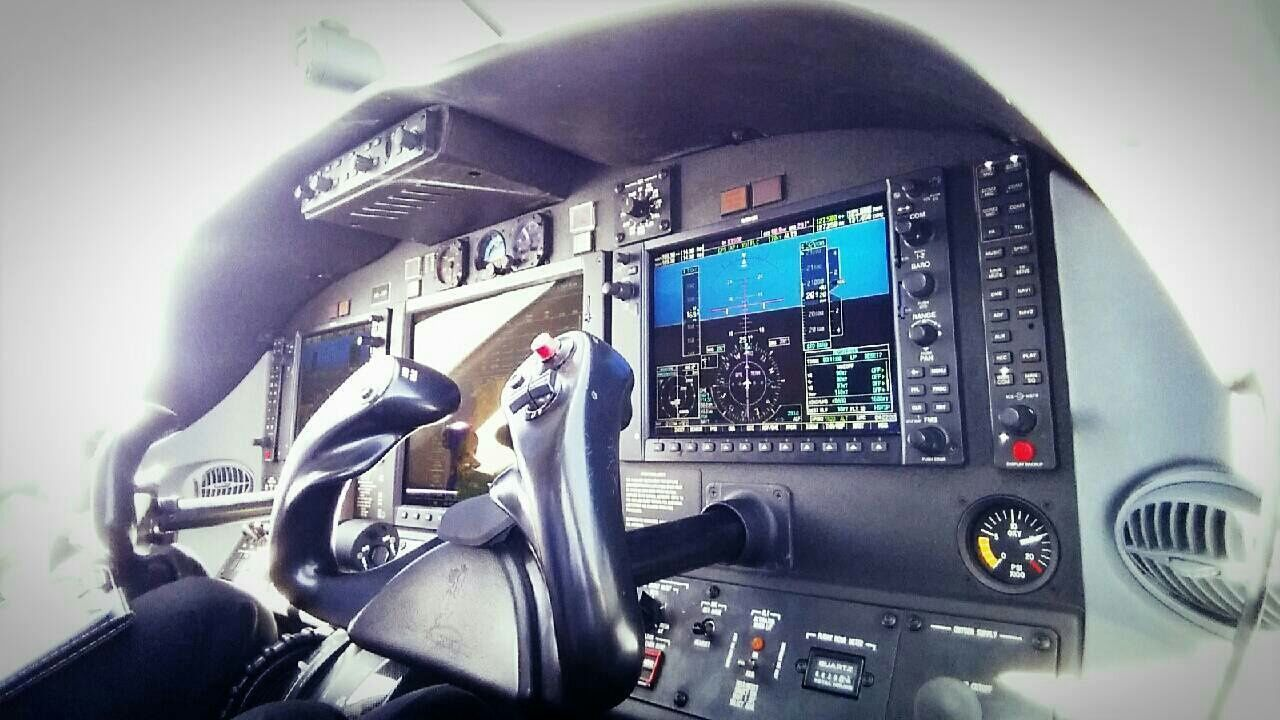 vehicle interior, transportation, cockpit, control, airplane, control panel, mode of transport, technology, indoors, day, air vehicle, one person, gauge, pilot, close-up, people