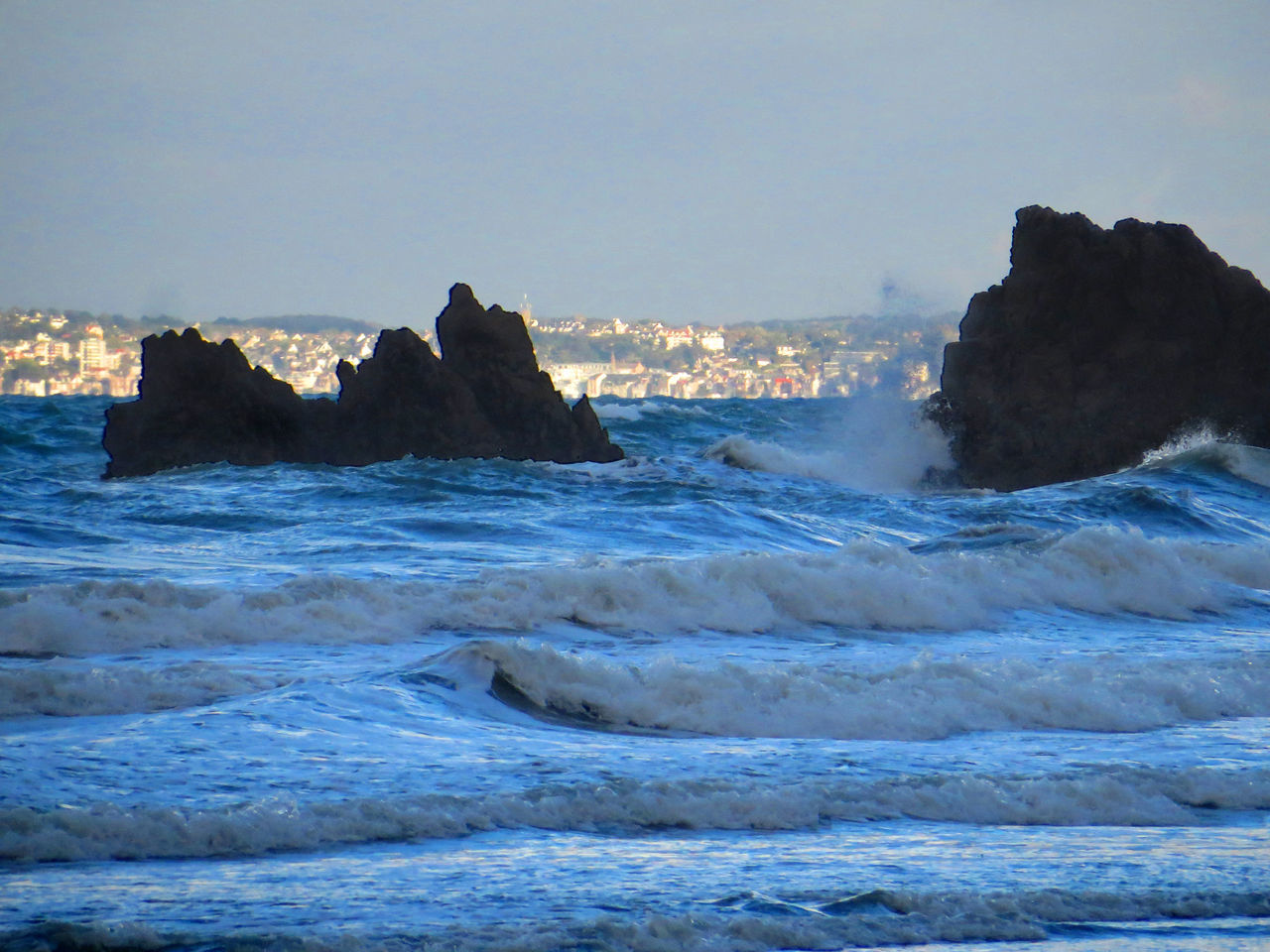 sea, wave, rock - object, nature, rock formation, motion, no people, beauty in nature, water, sky, waterfront, scenics, outdoors, clear sky, day, power in nature, horizon over water, force