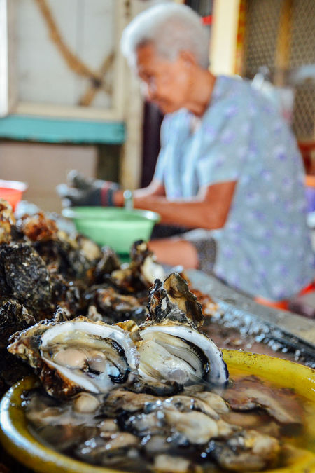 Close-up Delicious Fisherman Fishing Village Food And Drink Fresh Catch Freshness Old Lady Old Women Opening Opening Oyster Oyster  Oyster Farm Oysters Preparing Food Raw Food Ready-to-eat Sea Seafood Seaside Seaside Town Shells Taiwan Temptation Working The Photojournalist - 2017 EyeEm Awards