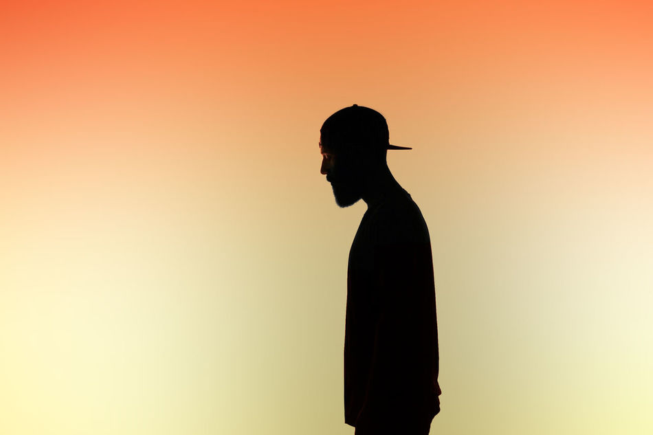 Beautiful stock photos of teenager, Beard, Cap, Colored Background, Contemplation