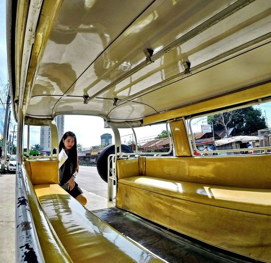 Boarding a Philippine Jeepney 4-wheel Drive Affordable Vehicle Cheap Fare Commuting Jeep Jeepney Public Transport Shuttle Bus The Street Photographer - 2016 EyeEm Awards