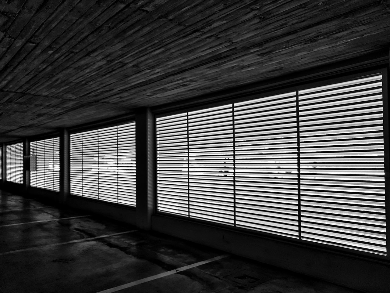 Window Blinds Built Structure No People Darkness And Light Sunlight Through The Window Lines From The Inside Looking Out Perspective Parking Indoors  Geometric Diagonal Lines Straight Lines Straight Lines Across