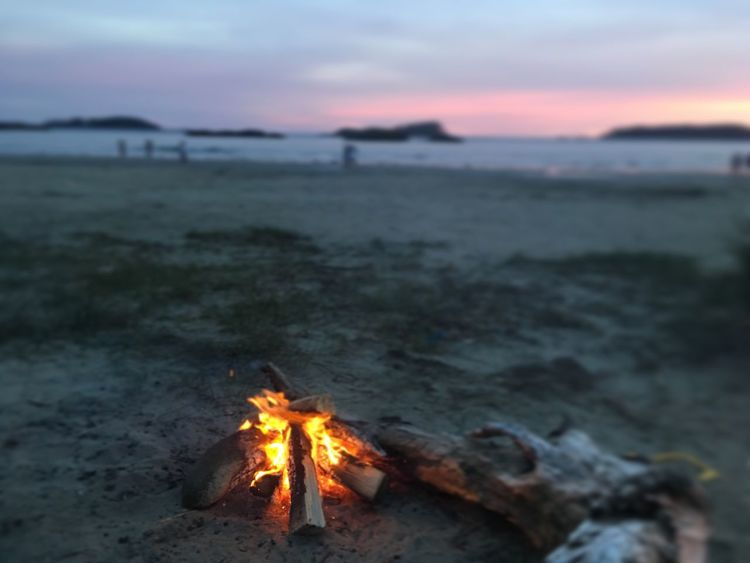 Sunset Burning Campfire Sea Nature Outdoors Flame Beach Beauty In Nature Focus On Foreground Landscape Scenics Be. Ready.