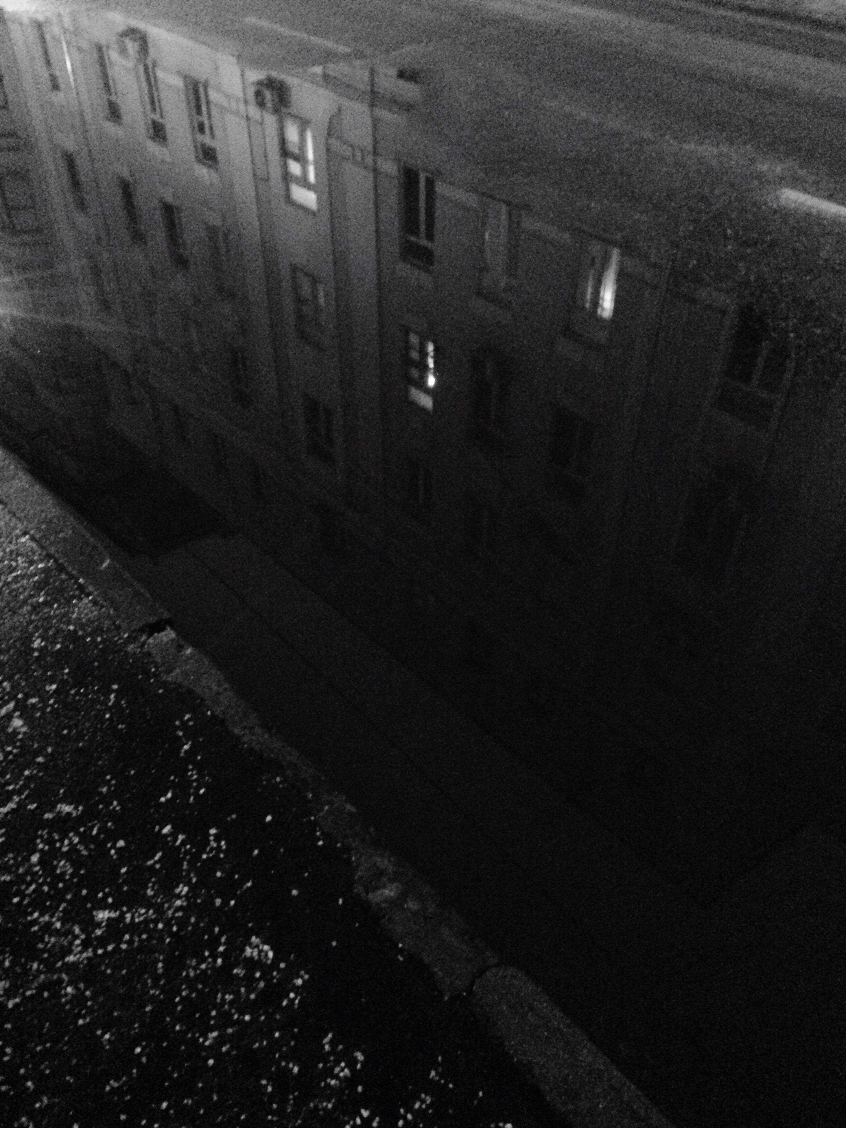 architecture, built structure, building exterior, street, transportation, building, road, high angle view, city, window, night, no people, outdoors, wet, residential building, puddle, residential structure, the way forward, illuminated
