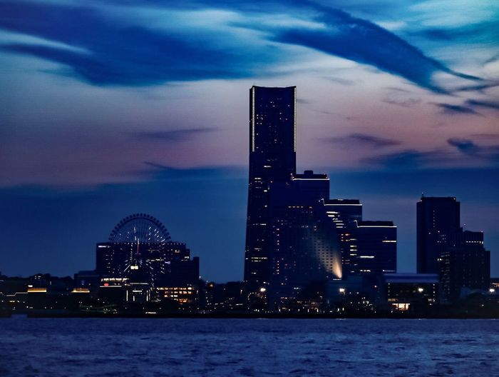 Sky Architecture Skyscraper Built Structure Building Exterior Cloud - Sky No People City Travel Destinations Cityscape Tall Waterfront Sea Water Arts Culture And Entertainment Illuminated Low Angle View Outdoors Urban Skyline Modern