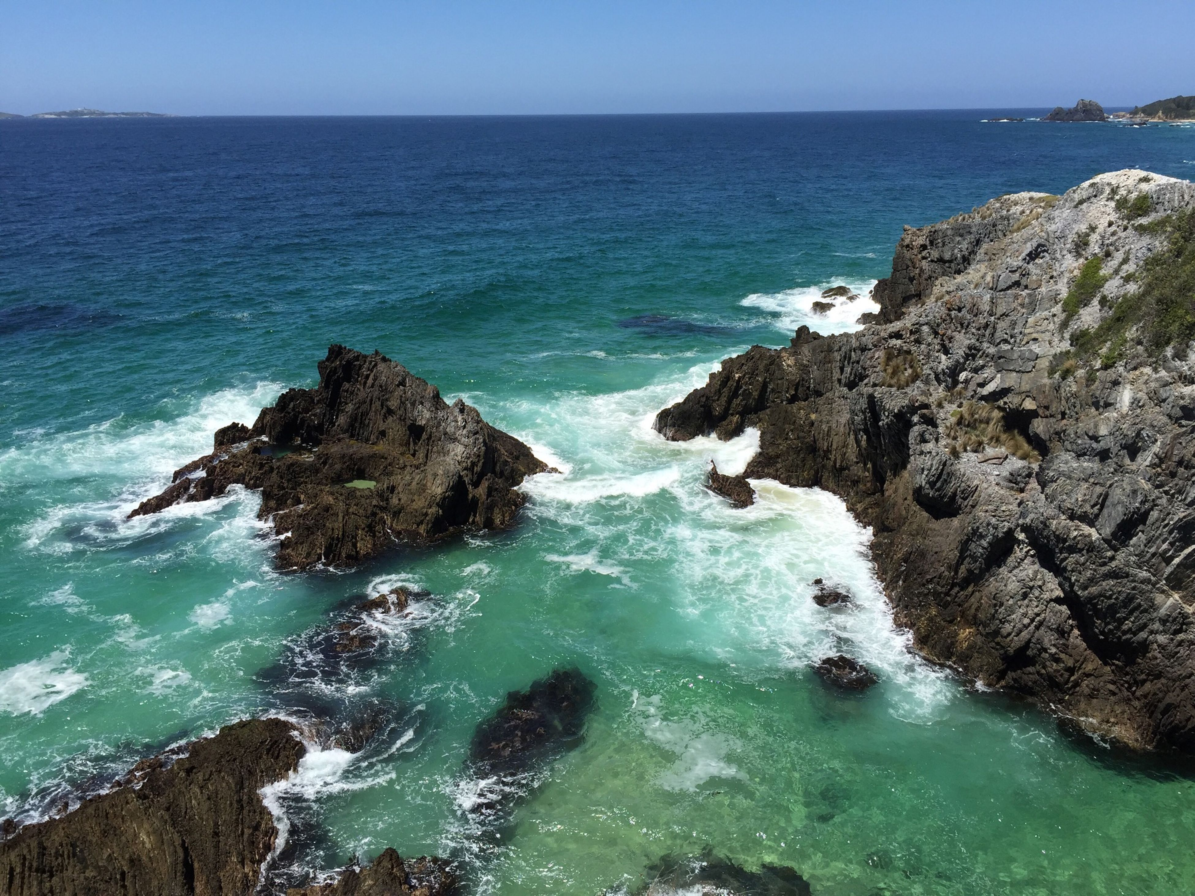 sea, water, horizon over water, scenics, beauty in nature, rock formation, tranquil scene, tranquility, rock - object, nature, rock, cliff, blue, coastline, idyllic, high angle view, seascape, clear sky, wave, day