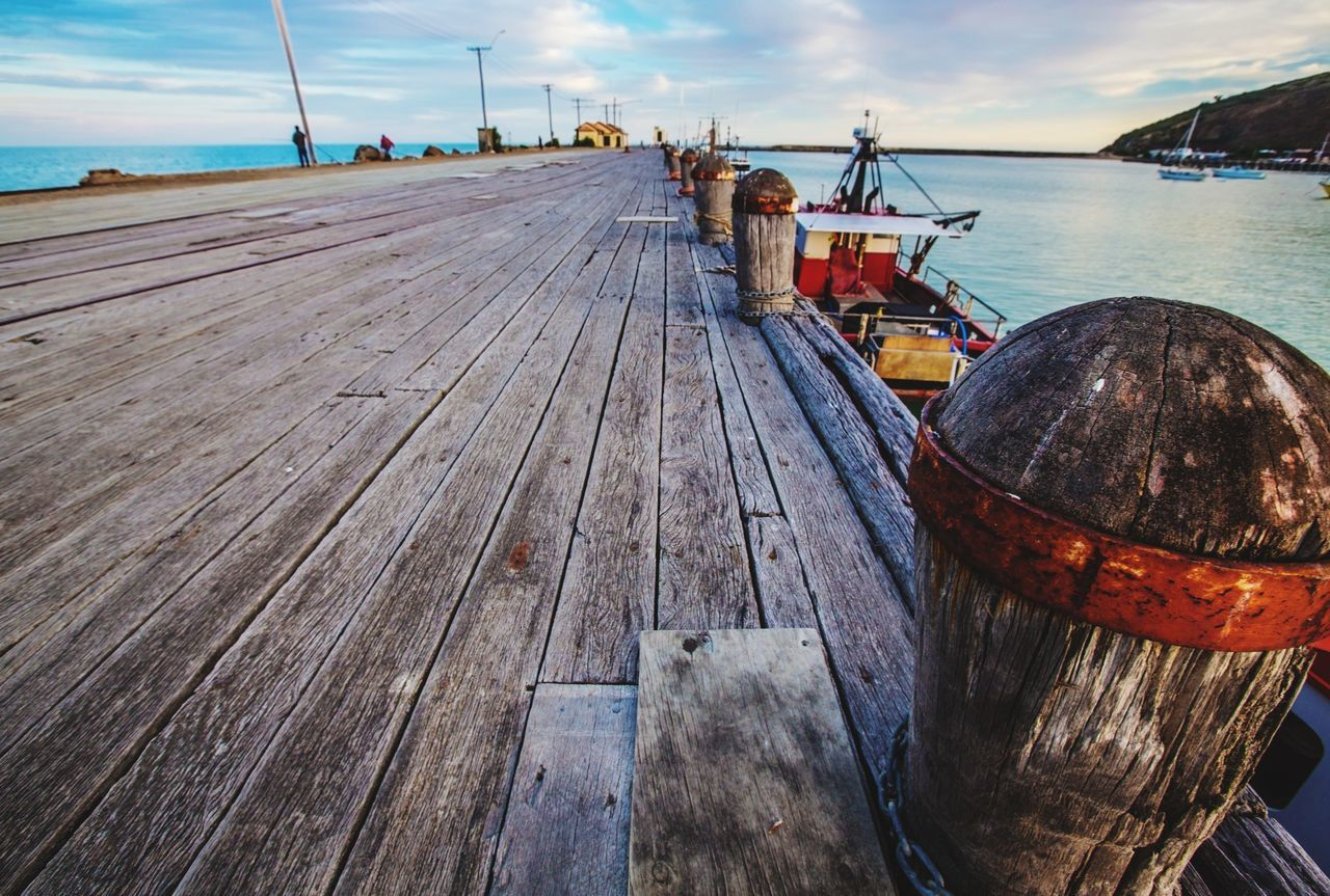 nautical vessel, boat, wood - material, mode of transport, water, transportation, pier, moored, day, sea, outdoors, jetty, sky, cloud - sky, harbor, real people, nature, boat deck, shipyard, wine cask, oil pump