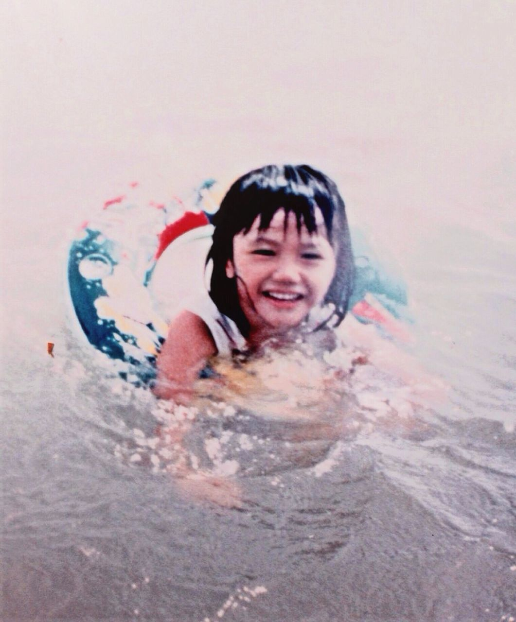 Close-up portrait of a girl swimming in water